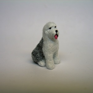 "1/4"" sheepdog sitting"